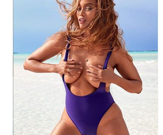 Tyra Banks grabs her boobs as she shares more racy photos from her Sports Illustrated Swimsuit edition cover