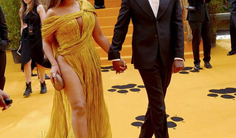 Beyoncé commands attention in a gold asymmetric gown as she joins husband Jay-Z at London's premiere of The Lion King (Photos)