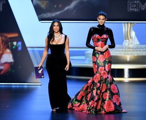 """Kim Kardashian and Kendall Jenner mocked by audience at the Emmys as they talk about being """"real"""" people while presenting award (vidoe)"""
